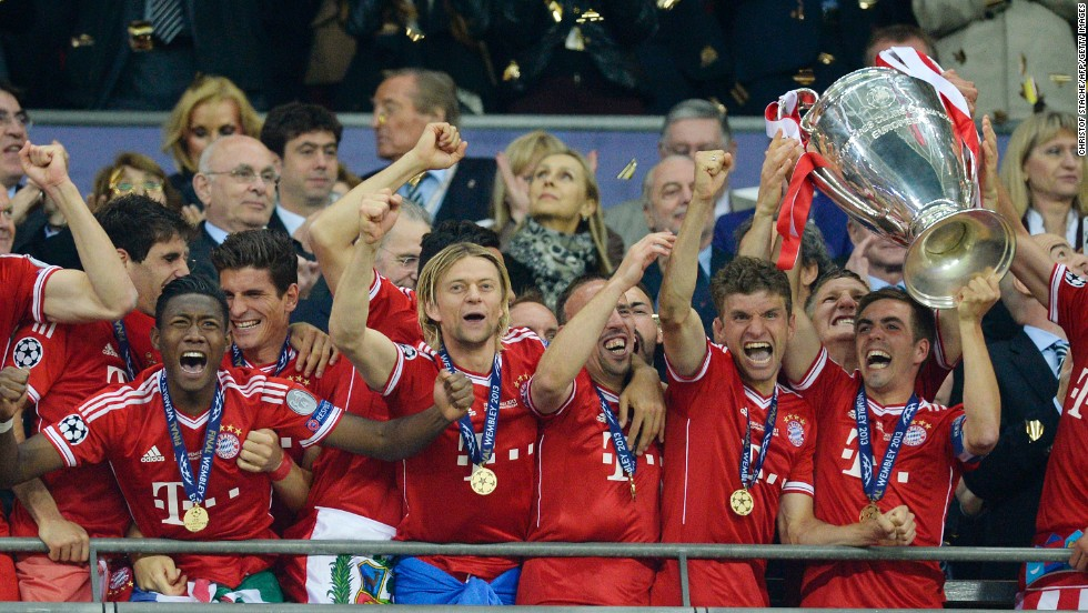 Bayern Munich Players Lift The Trophy As They Celebrate Winning UEFA Champions League Final After