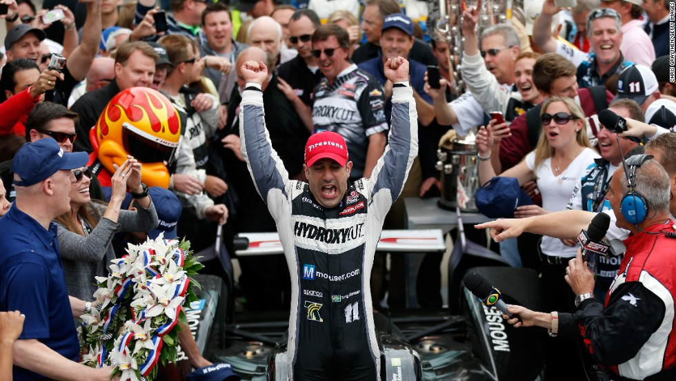 Kanaan celebrates in victory lane. The race featured a record 14 leaders and 68 lead changes