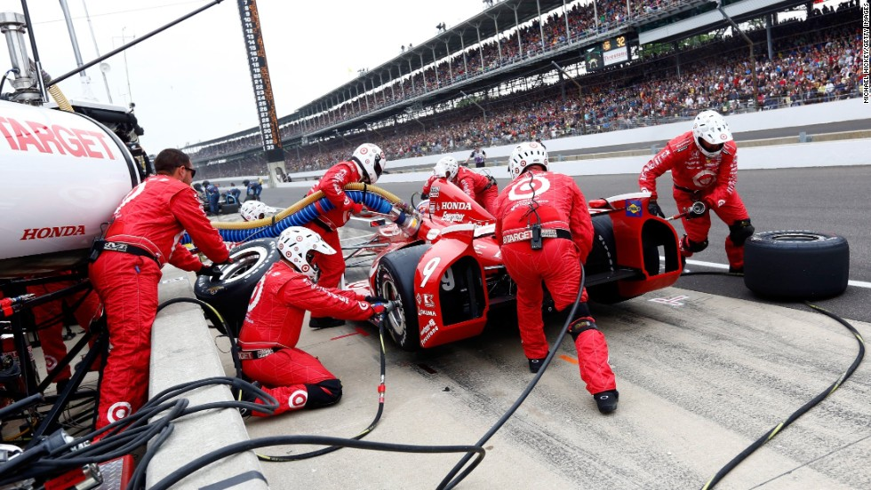 Scott Dixon of New Zealand makes a pit stop in the No. 9 Target Chip Ganassi Racing Honda.