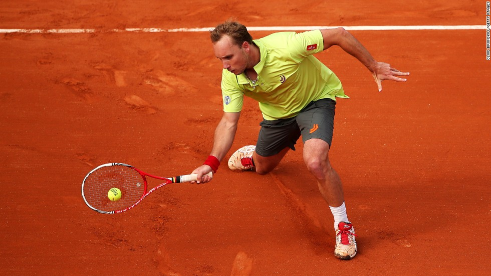 Darcis makes a forehand swing against Llodra  on May 26.