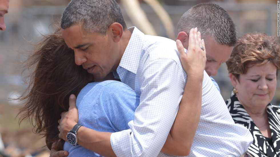 President Barack Obama is greeted as he tours the tornado-ravaged area near Moore, Oklahoma, on Sunday, May 26.