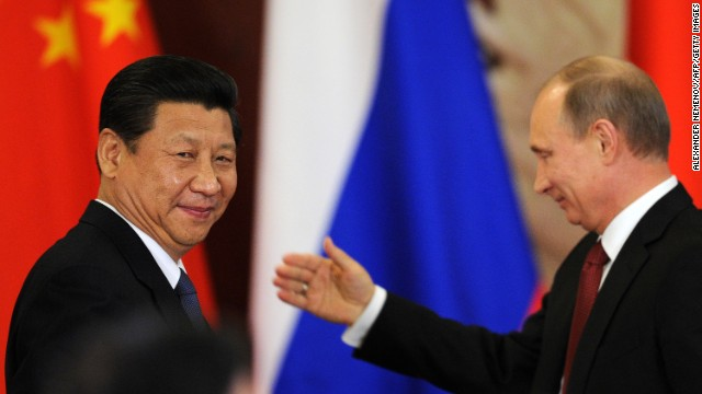 Russia's President Vladimir Putin greets China President Xi Jinping during a document signing ceremony in Moscow, on March 22, 2013