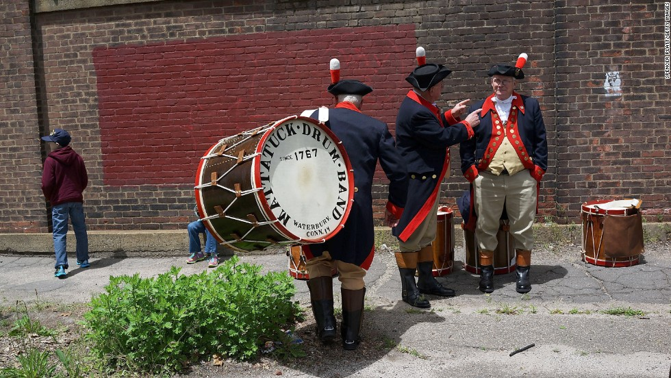 "Members of the Mattatuck Drum Band, <a href=""http://mattatuck.org/"" target=""_blank"">billed as the country's oldest fife and drum band</a>, warm up before joining the Memorial Day parade in Waterbury on May 26."