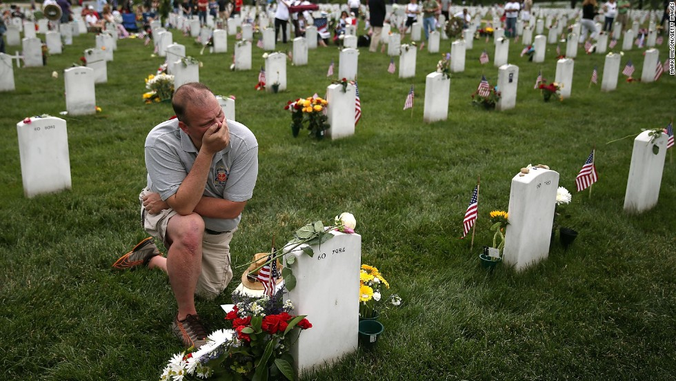 Alex Burgess gets emotional at Arlington National Cemetery in Virginia on Monday, May 27, as he visits the grave of a friend who was killed in Iraq. People across the country paid tribute to fallen military service members throughout the Memorial Day weekend.