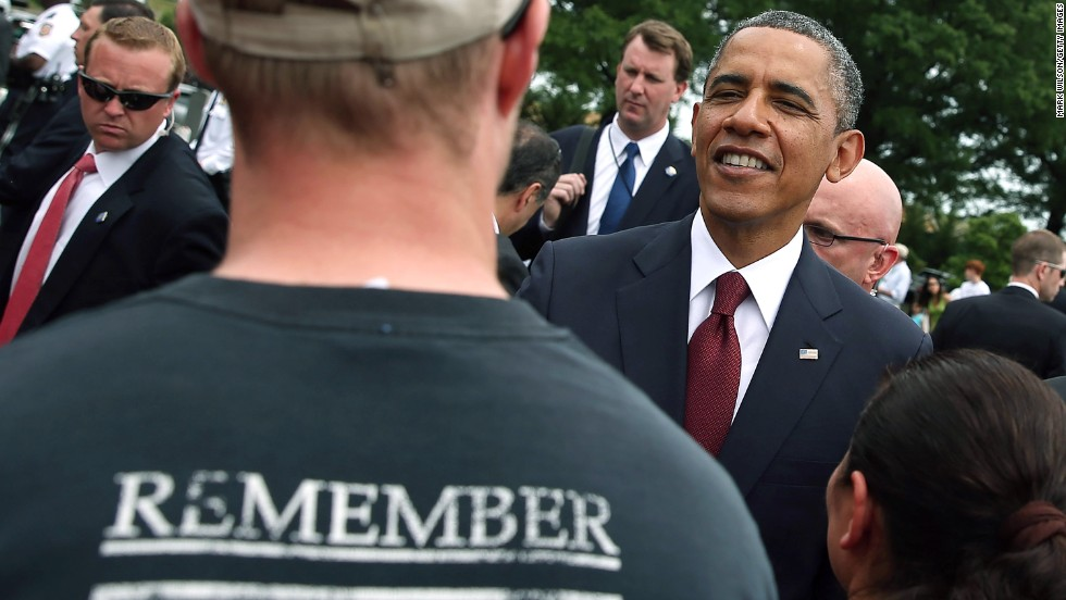 President Barack Obama greets people while visiting Arlington National Cemetery on May 27.