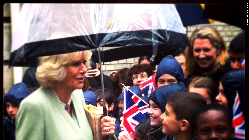 Camilla speaks with children greeting her outside the headquarters of la Garde Républicaine -- the Republican Guard.