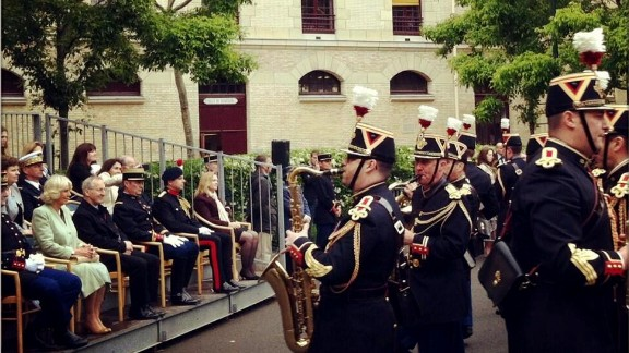 Camilla attends a ceremony with the horse cavalry regiment of la Garde républicaine.