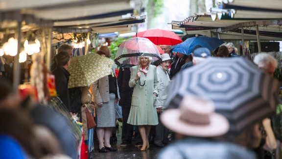 """Camilla strolls through the Parisian market. At another stall, she bought five dresses for her grand-daughters from a trader who described the duchess as polite and said she """"loved everything."""""""