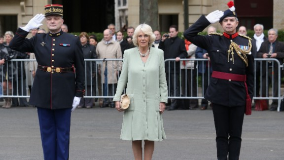 Camilla poses with members of la Garde républicaine.