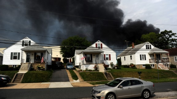 Smoke billows from a train derailment that caused a major explosion in the Rosedale neighborhood outside of Baltimore on Tuesday, May 28. A CSX freight train collided with a commercial truck and derailed leading to an explosion that a witness said could be felt blocks away.