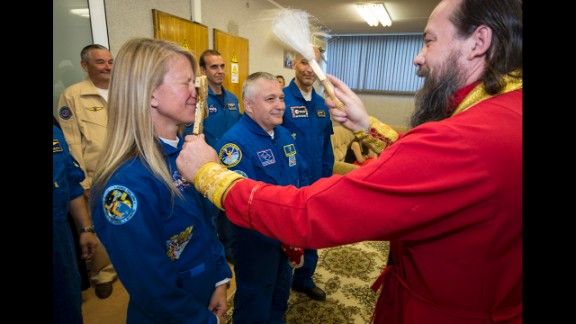 The crew receive a traditional blessing from an Orthodox priest on May 28.