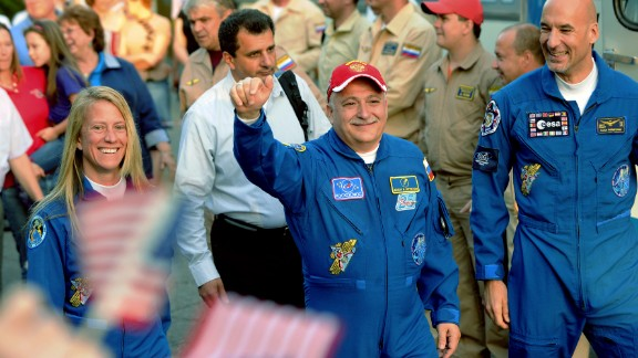 Nyberg, Yurchikhin and Parmitano wave to their families during a send off on May 28.
