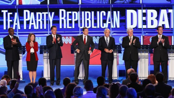 From left, Republican presidential candidates Herman Cain, Bachmann, Mitt Romney, Texas Gov. Rick Perry, Rep. Ron Paul, former House Speaker Newt Gingrich and Rick Santorum participate in a September 2011 presidential debate sponsored by CNN and the Tea Party Express in Tampa, Florida.