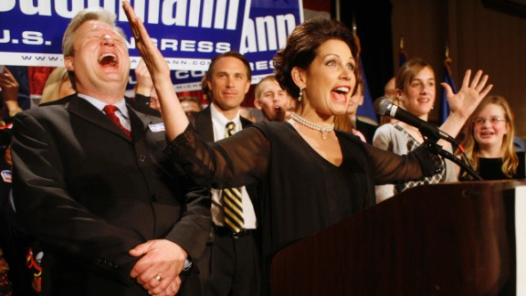 Bachmann, with her husband Marcus, left, at her side, declares victory in Minnesota's 6th Congressional District race in November 2006 in Bloomington, Minnesota. The congresswoman is now serving her fourth term.