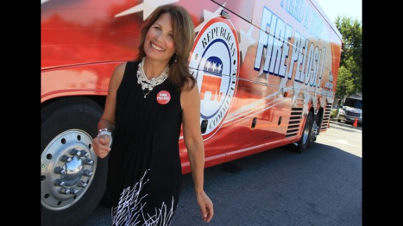 """Bachmann participates in the """"Fire Pelosi"""" bus tour in September 2010. The Republican National Committee launched the campaign against then-House Speaker Nancy Pelosi following passage of the bill to overhaul health care."""