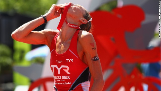 Chrissie Wellington celebrates winning the Challenge Roth Triathlon with a new long distance world record on July 10, 2011.