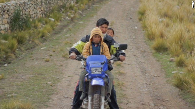 No school bus? Pile on a motorbike.
