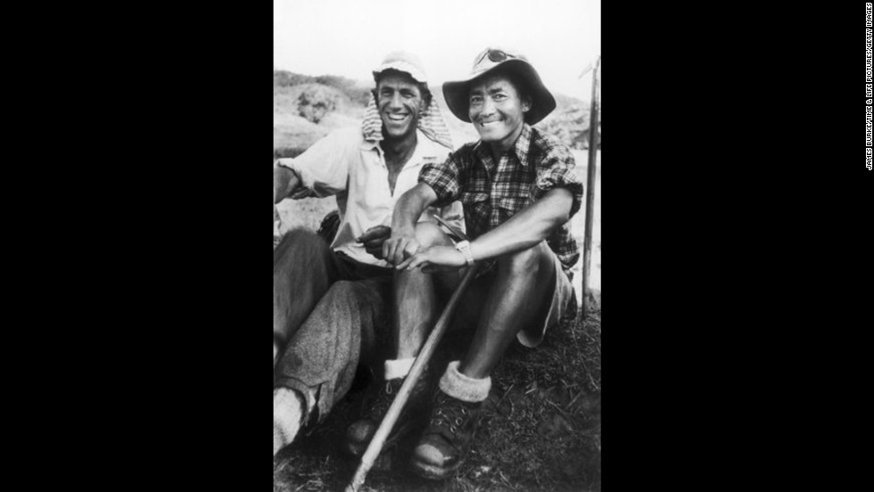Edmund Hillary and Tenzing Norgay smile after descending from Mount Everest in 1953. The pair were the first climbers to summit the world's tallest mountain.