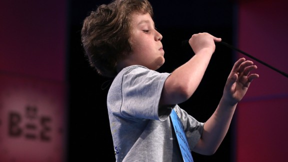 "Alexander Schembra of Lillington, North Carolina, lowers the microphone before attempting, and failing, to spell ""Beethovenian"" during round three on May 29. Beethovenian is an adjective used to describe things that are related to or characteristic of Ludwig van Beethoven, his works or musical style."