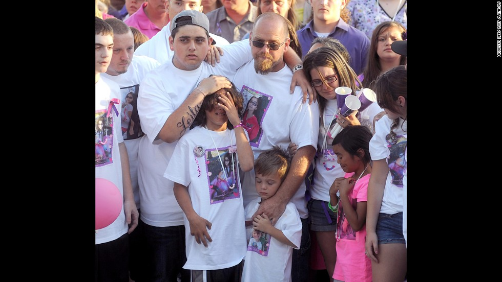 Leila Fowler's family mourns at a vigil for her on April 30.