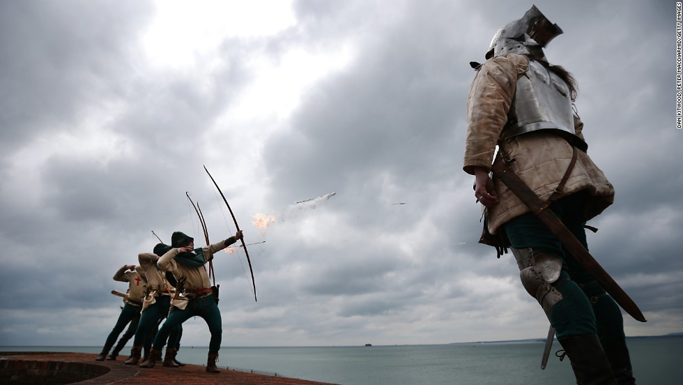 Purbrook Bowmen fire a volley of flaming arrows from Southsea Castle as part of a day of events to mark the opening of the Mary Rose Museum on May 30, 2013 in Portsmouth, England.