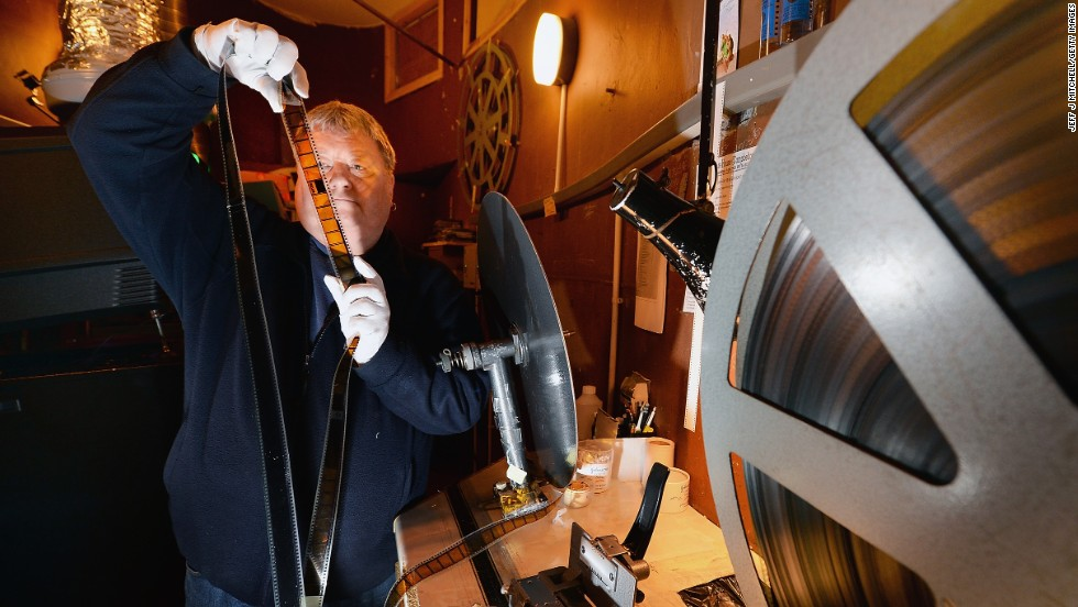 When you go to the movies, you may imagine someone like this guy in the projection booth: Russell Carroll, general manager of the Picture House theater in Campbeltown, Scotland. More likely, however, today's projection booth is unmanned, occupied only by digital projectors and hard drives.