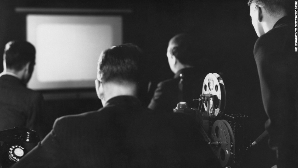 A Kodak projector is used for a private screening in 1937. Until recently, showing a feature film required knowledge of how to thread a projector and swap reels at just the right moment.