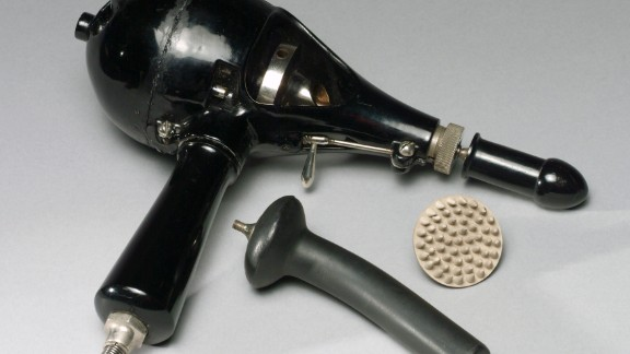 A Shelton vibrator, dating to the 1910s, and some of its attachments.