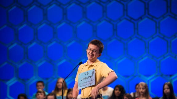 "Joseph Kirkpatrick, from Indiana, reacts after misspelling ""ignimbrite,"" a hard rock formed from volcanic ash, in the fifth round on May 30."