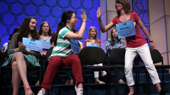 "Isabel Cholbi, right, of San Bernardina, California, celebrates after spelling ""telergy,"" in round five on May 30. Telergy is the hypothetical action of one person's thoughts and desires on the brain of a different person via an unknown form of energy transmission."