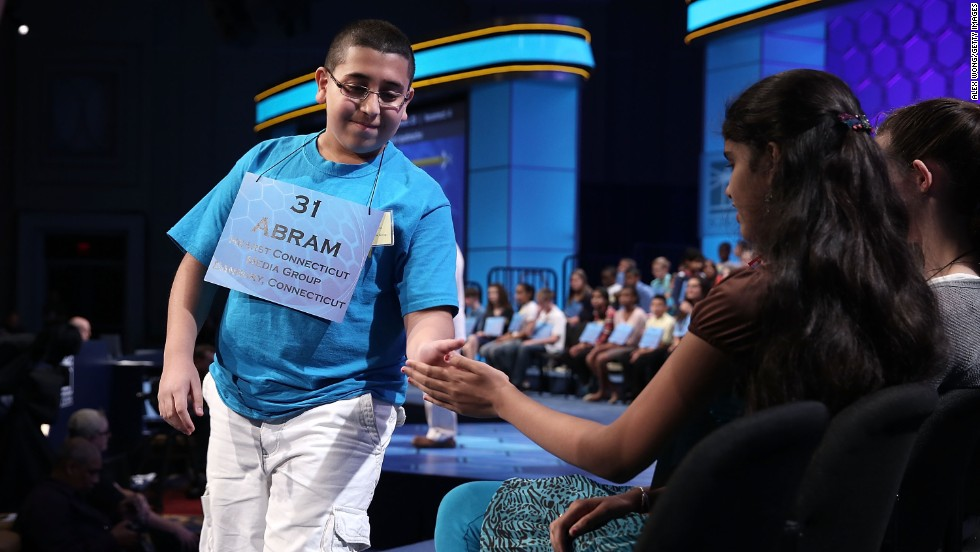 "Abram Mikhaeel Goda, left, of Bridgeport, Connecticut, hi-fives Himanvi Kopuri of Denver, Colorado, after he spells ""nomenclative,"" of or relating to name or the act of naming, in round three on May 29."