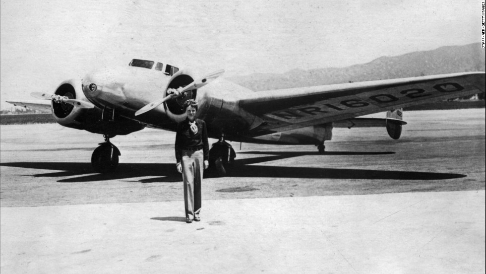 Earhart poses in front of her plane in the 1930s.