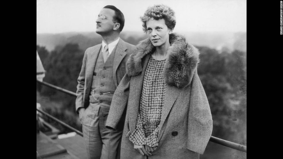 Earhart stands on the roof of the Hyde Park Hotel in London with Capt. Hilton H Railey on June 20,1928.