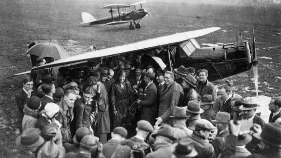 A crowd surrounds Earhart, center, upon arrival at Hanworth airfield in London after she crossed the Atlantic Ocean in 1932.