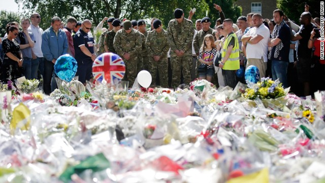 People and soldiers gather on May 26 outside the Royal Artillery Barracks, near where Drummer Lee Rigby was killed.