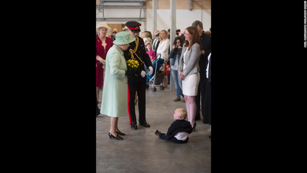 The families of serving personnel greet the queen.