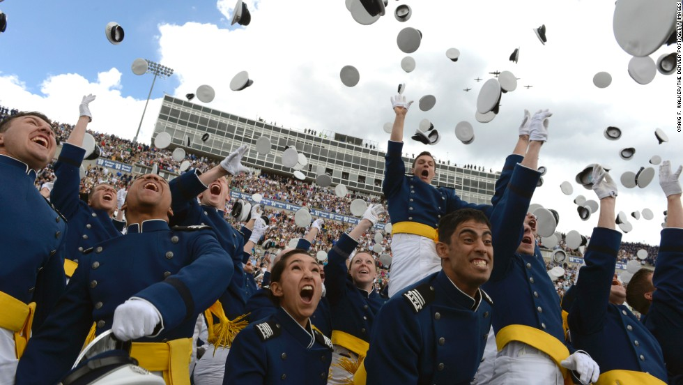 Graduates of the United States Air Force Academy toss their caps in the air during the graduation ceremony at Falcon Stadium in Colorado Springs on Wednesday, May 29. President Barack Obama addressed the issue of student loan debt Friday, May 31, at the White House as he urged students and their families to mount pressure on congressional Republicans to prevent a jump in some student loan rates set to occur on July 1.