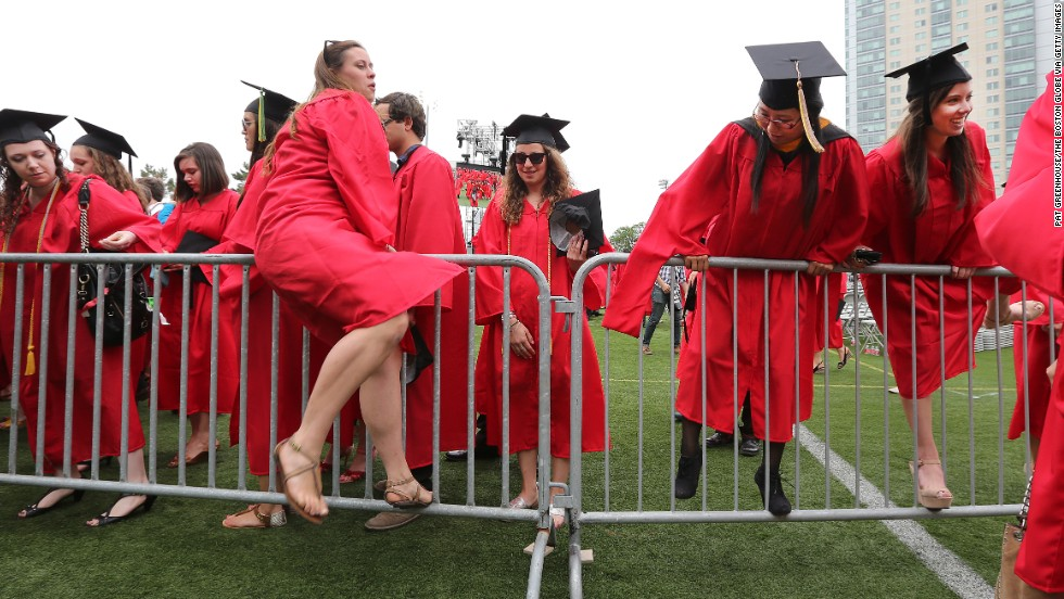 Graduates flee the grounds of Nickerson Field after Boston University's commencement ceremony on May 19, in Boston.