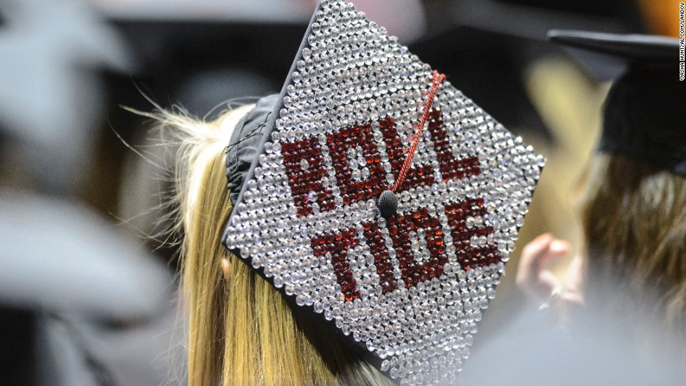 Prospective graduates display messages on their mortar boards during Alabama's spring commencement on May 4, at Coleman Coliseum in Tuscaloosa, Alabama.