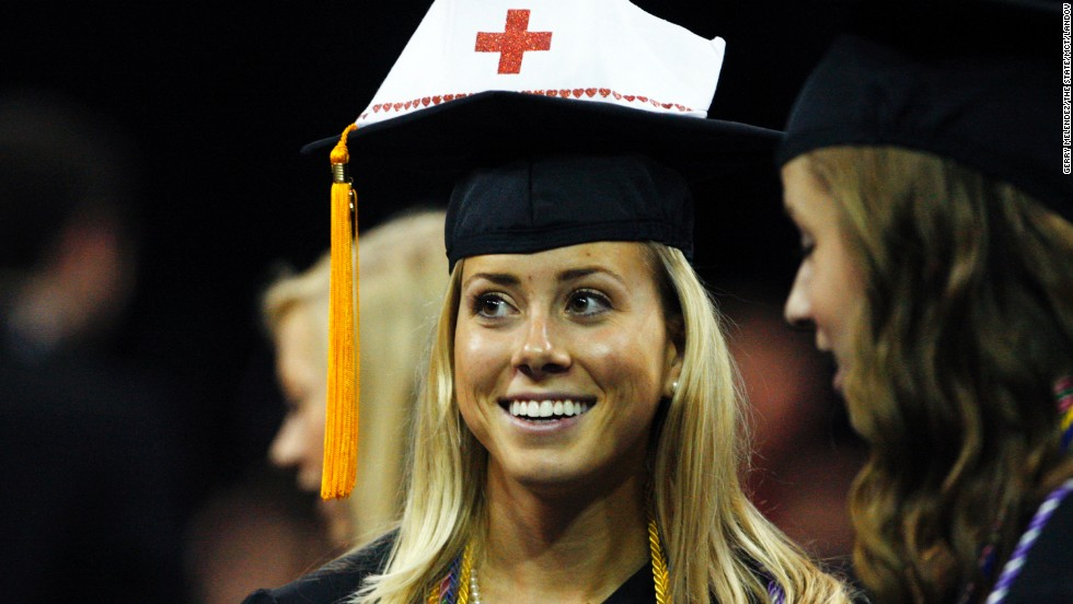 English Hooper, 21, of the School of Nursing, waits among other students for the beginning of the University of South Carolina commencement ceremony in Columbia, South Carolina, on May 10.