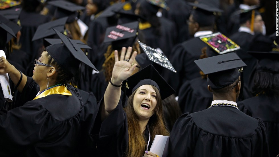 Graduates of Bowie State University wave to friends and family during the graduation ceremony at the Comcast Center on the campus of the University of Maryland on May 17, in College Park, Maryland.