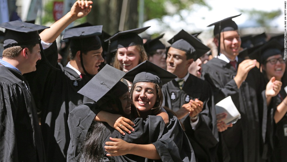 Harvard student Alexandra Marie Garcia, center, hugs another graduate at the 362nd commencement at Harvard University on Thursday, May 30, in Cambridge, Massachusetts.