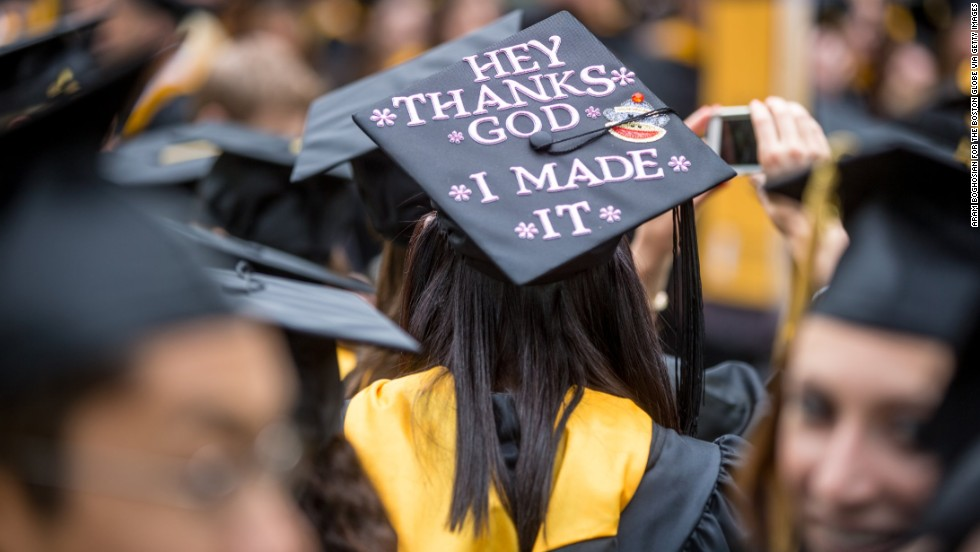 A student displays a message on the mortar board of her cap during the Framingham State University commencement ceremony on May 19, in Framingham, Massachusetts.
