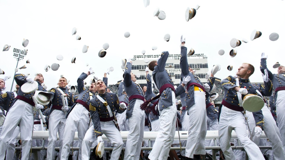 Graduating cadets toss their hats after graduation at the United States Military Academy at West Point during the 215th commencement ceremony on May 25, in West Point, New York.