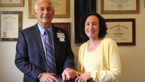 Goldstein and his wife of 38 years, Sue, who is program coordinator for San Diego Sexual Medicine. On the wall behind them are some of Goldstein's awards; in 2009, he received the gold medal from the World Association of Sexual Health for his lifetime achievements in sexual medicine.