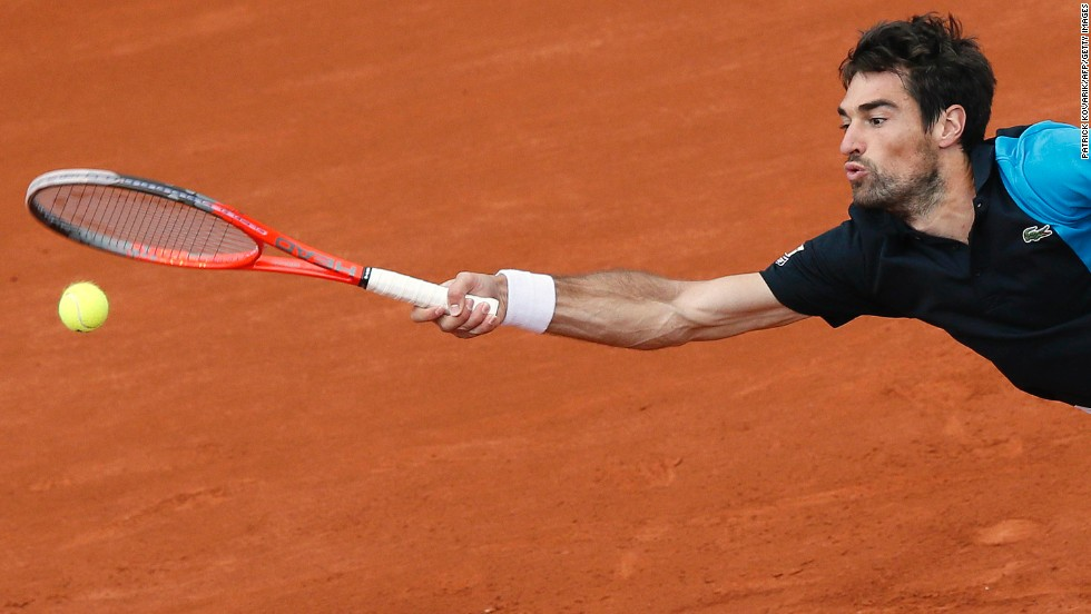 France's Jeremy Chardy stretches to hit the ball against France's Jo-Wilfried Tsonga during their third-round match at the French Open at the Roland Garros stadium in Paris on Friday, May 31. Tsonga beat Chardy 6-1, 6-2, 7-5.