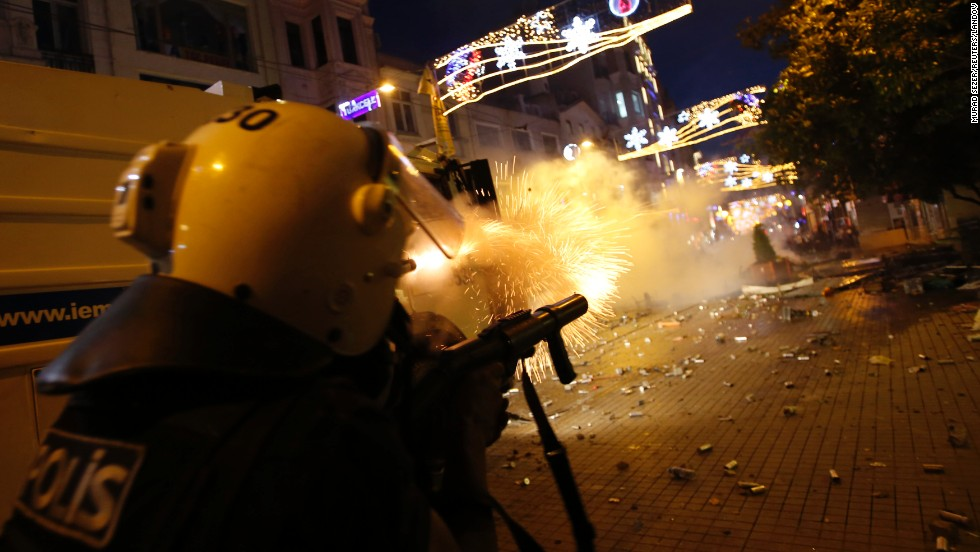 Riot police fire tear gas into the crowd of protesters overnight on Friday, May 31.