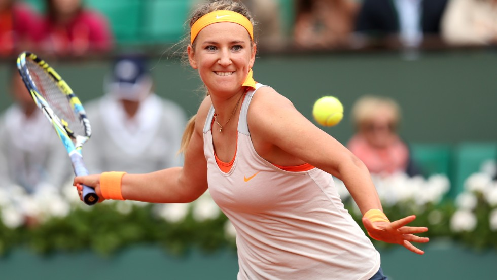 Victoria Azarenka of Belarus returns a forehand in her women's singles match against Alize Cornet of France on June 1. Azarenka defeated Cornet 4-6, 6-3, 6-1.