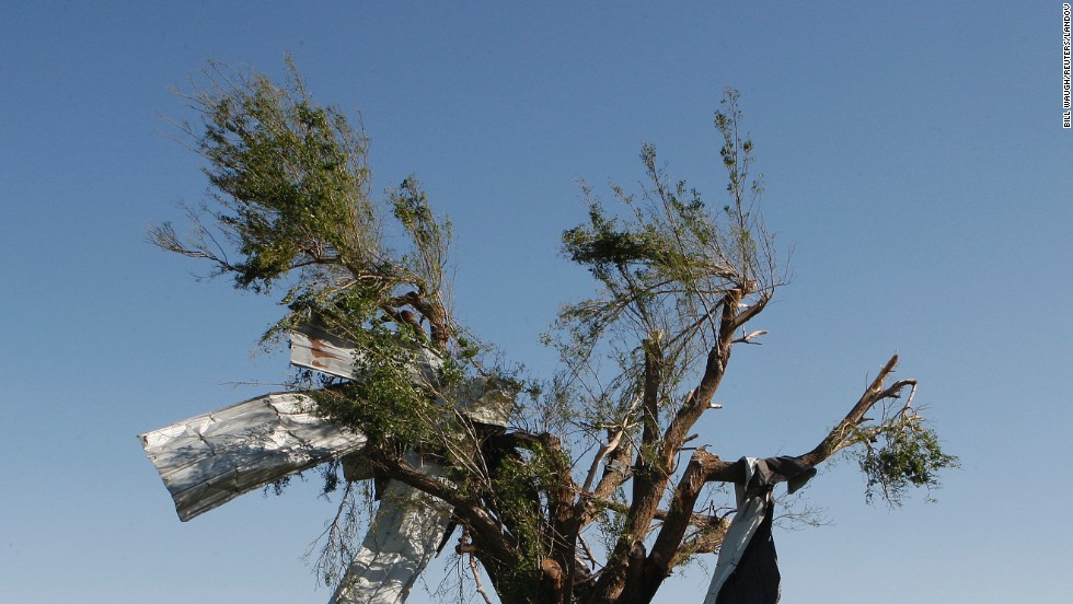 High winds left sheet metal wrapped around the branches of this tree along Route 66 in El Reno on June 1.
