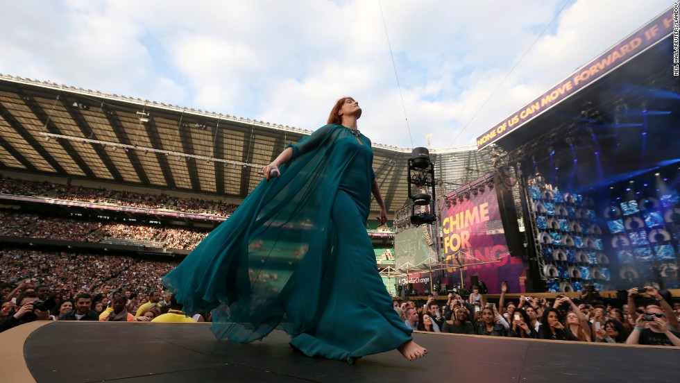 Florence Welch of Florence and the Machine strides across the stage during their performance.